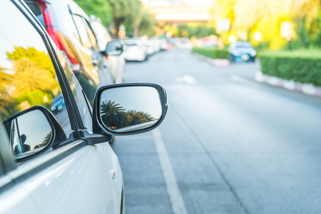 view to outside: side rear-view mirror on a modern car