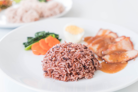 barbecued: Barbecued red pork in sauce with berry rice
