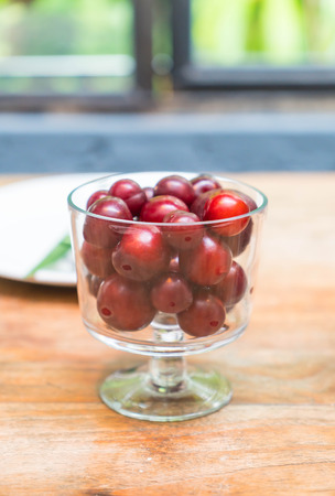 dinning: cherry in bowl on dinning table Stock Photo