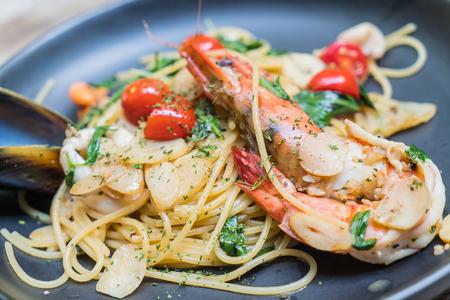 stir-fried spaghetti seafood in restaurant