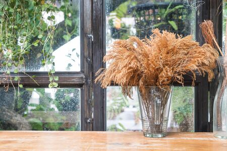 dinning table: dry flower decoration on dinning table