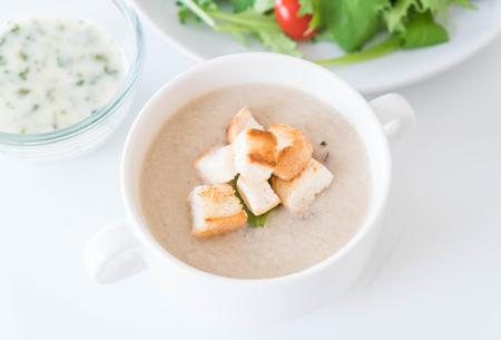 preserve: mushroom soup and bread in white ceramic cup