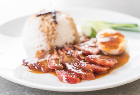 barbecued: Barbecued red pork in sauce with rice Stock Photo