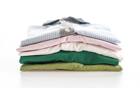 drycleaning: mens shirts stacked on white background Stock Photo