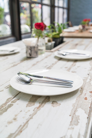 table set on wooden dinning table Stock Photo
