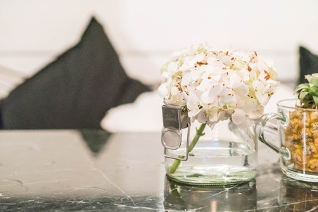 dinning table: flower in glass decoration on dinning table