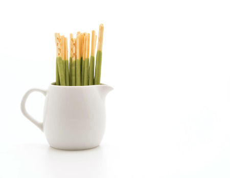 flavored: biscuit stick with green tea flavored on white background