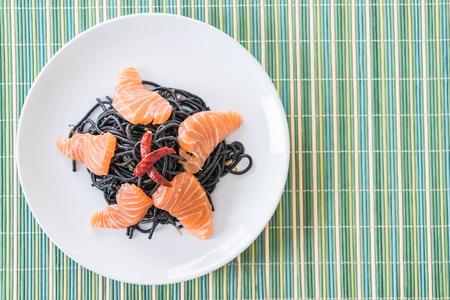 spicy black spaghetti with salmon - fushion food style