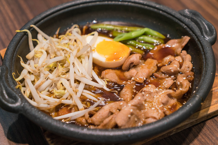 sizzle: Korean spicy bbq pork served on a hot plate with side dishes and rice