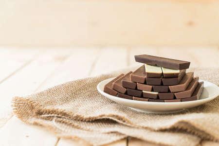 chocolate bars on wood background Stock Photo