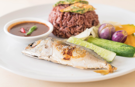 Fried mackerel with shrimp paste sauce and berry rice Stock Photo