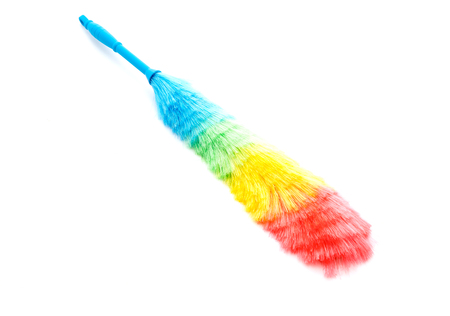 duster: Soft colorful duster with plastic handle on white background Stock Photo