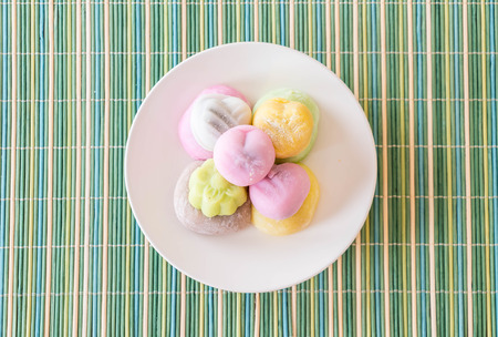 cream and green: colorful dessert mochi on white plate Stock Photo