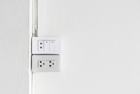 Electrical switch and plug on empty wall