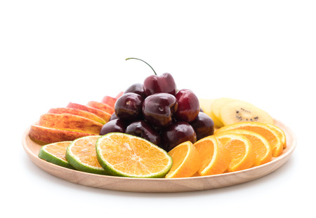 sliced fruit: mixed sliced fruit in wood plate