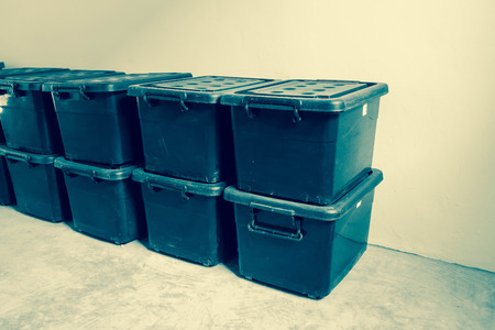 storage: plastic storage case in the room - vintage effect filter Stock Photo
