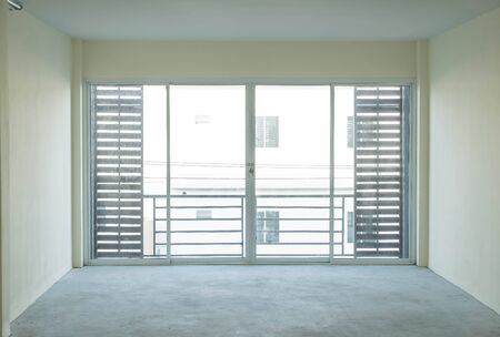 room door: empty glass door in living room interior background Stock Photo