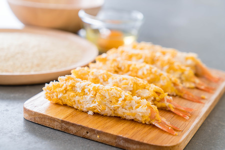 batters: batter-fried prawns on wood board with ingredients