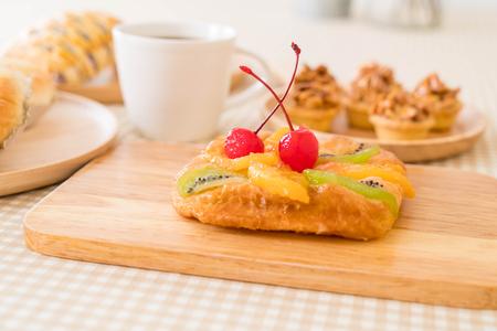 danish: danish mixed fruit with jam on the table Stock Photo