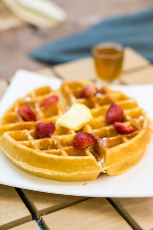 butter waffle with honey and strawberry - dessert Stock Photo