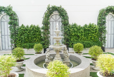 water feature: fountain decoration in garden with empty space Stock Photo
