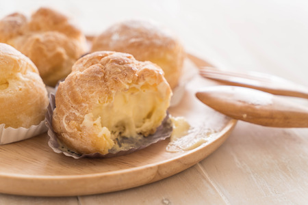 cream puff on wood plate