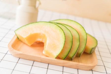Cantaloupe: fresh cantaloupe melon for dessert on table Stock Photo