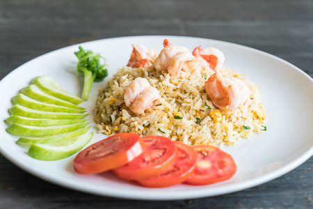 fried rice with shrimps on wood background Stock Photo