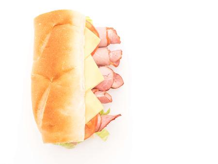 Ham and salad submarine sandwich on white background