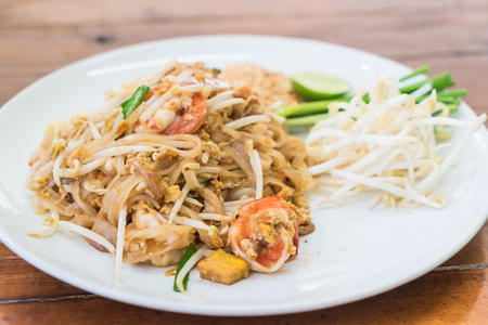 Stir-fried noodle with shrimp or Shrimps Pad Thai (Thailands national dishes)