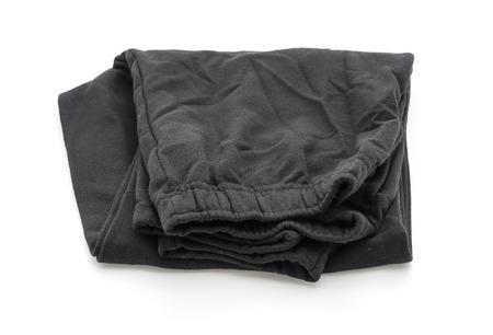 Black tracksuit pants on white background