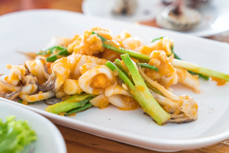 Stir-Fried Squid with Salted Eggs on plate Stock Photo - 70920054