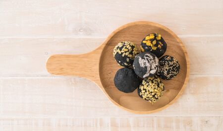 pure de papa: Charcoal potato ball on wood plate