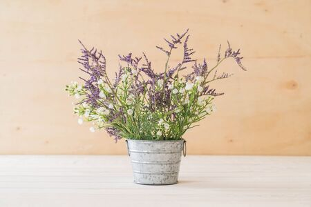 statice and caspia flowers in vase