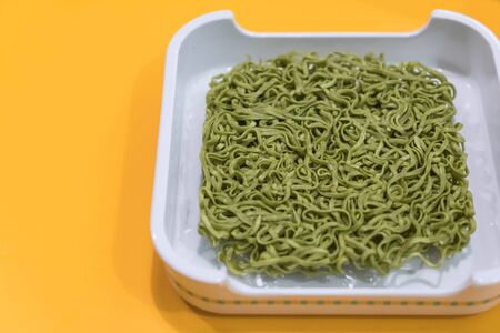 Jade noodles or green noodle on white plate Stock Photo