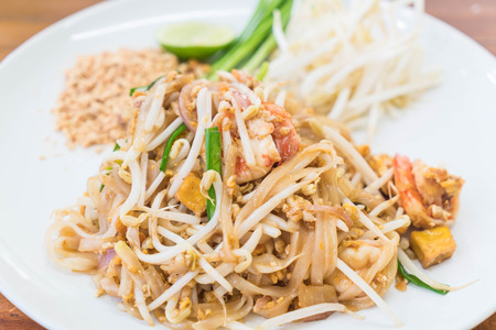 Stir-fried noodle with shrimp or Shrimps Pad Thai (Thailands national dishes)