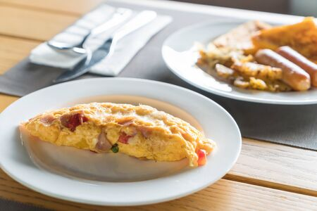 scrambled: Homemade Ham and Cheese Omelette for breakfast Stock Photo