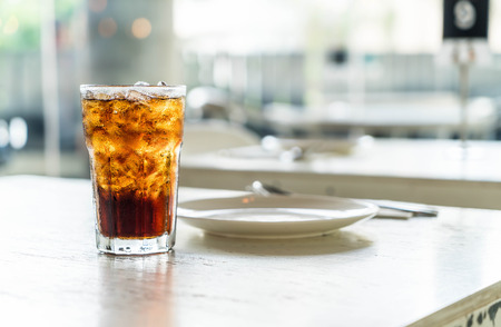 fizz: iced cola glass on the table
