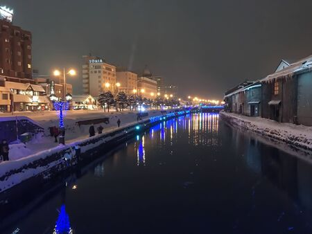 hoarfrost: blur of Night view and Light on Otaru canal, snow is stopping in Otaru Snow Light Path Festival. Hokkaido, Japan.