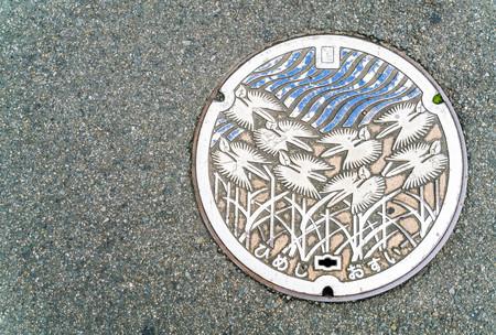 crack pipe: Drain cap japan style on walkway in Himeji, Hyogo Prefecture, Japan Editorial