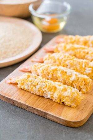 batter-fried prawns on wood board with ingredients