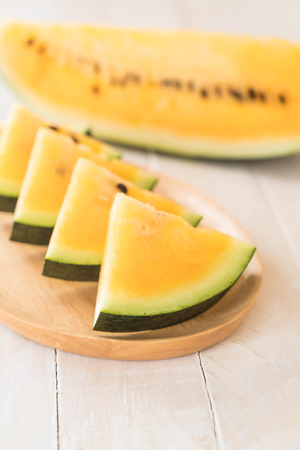 fresh yellow watermelon on wood Stock Photo