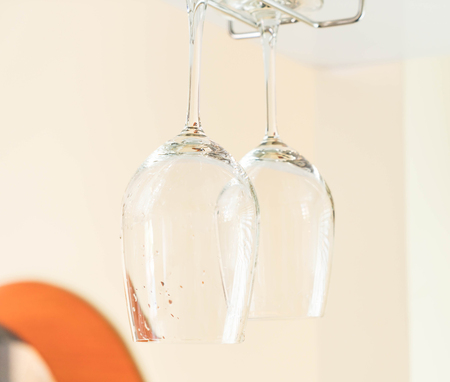 bar ware: Selective focus point on Wines glass hanging on bar Stock Photo
