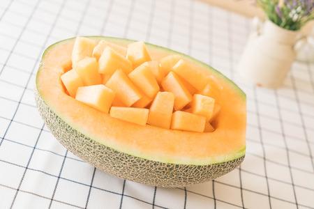 fresh cantaloupe melon for dessert on table Stock Photo