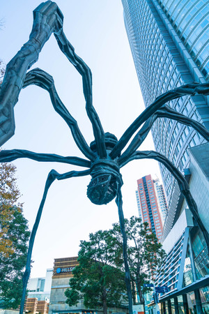 TOKYO, JAPAN - NOVEMBER 18 2016 : Maman - a spider sculpture by Louise Bourgeois, situated at the base of Mori tower building in Roppongi Hills, Tokyo Japan