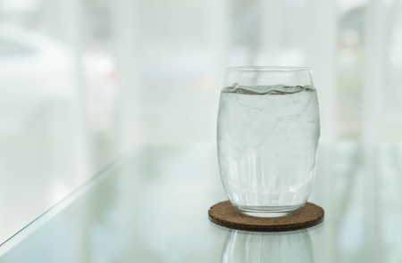 glass of water on dinning table Stock Photo