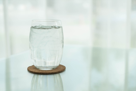 purified: glass of water on dinning table Stock Photo