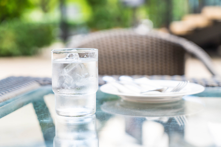 a glass of water on dinning table