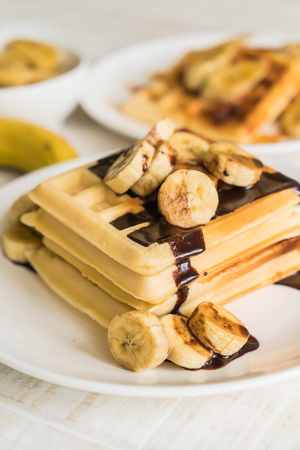 butter icing: banana waffle with chocolate on white plate Stock Photo
