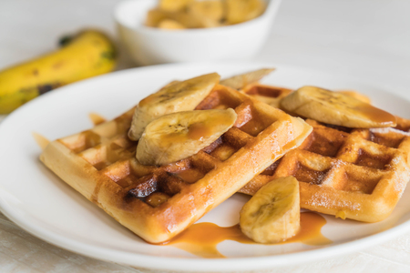 butter icing: banana waffle with caramel on white plate Stock Photo